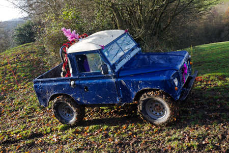 motorcar: GREAT MALVERN, UK - DECEMBER 8: An unnamed driver competing in the SCOR UK trials championship negotiates a steep sided hillside at the Croft Farm round on December 8, 2013 in Great Malvern Editorial