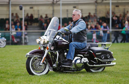 harley davidson motorcycle: NEWBURY, UK - SEPTEMBER 21: Members of a local Oxfordshire Harley Davidson motorcycle owners club parade around the main arena for the public at the Berks County show on September 21, 2013 in Newbury Editorial