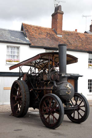 traction engine: AMERSHAM, UK - SEPTEMBER 13: A vintage industrial traction engine is parked on the side of the highway as a static display at the Amersham Heritage Day festival on September 13, 2015 in Amersham. Editorial