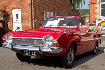 corsair: AMERSHAM, UK - SEPTEMBER 7: An iconic vintage Ford Corsair is lined up on the High Street alongside other classic vehicles at the annual Amersham Heritage Day show on September 7, 2014 in Amersham