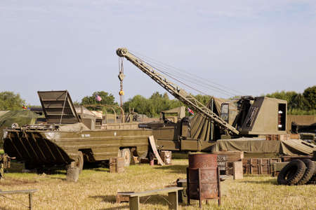 ww2: WESTERNHANGER, UK - JULY 21: A WW2 US supply dump has been recreated in the living history section for the public to view at the War & Peace Revival show on July 21, 2016 in Westernhanger