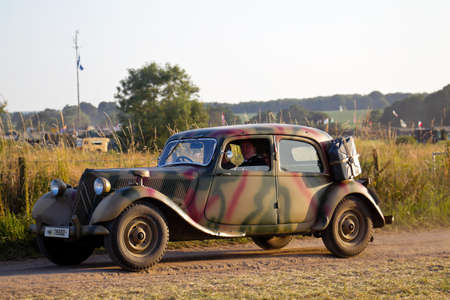 perimeter: WESTERNHANGER, UK - JULY 20: A vintage Citroen automobile drives around the perimeter road of the show arena at the War & Peace Revival show on July 20, 2016 in Westernhanger