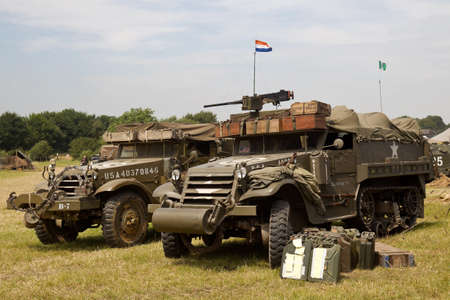 ww2: WESTERNHANGER, UK - JULY 20: Two vintage US army WW2 armoured halftracks stand on public display in the living history section at the War & Peace Revival show on July 20, 2016 in Westernhanger Editorial