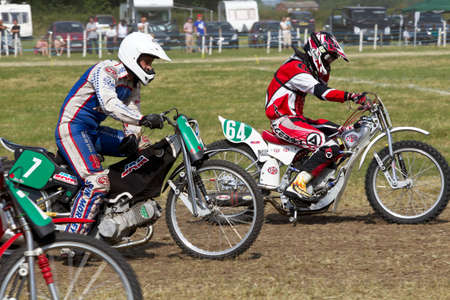 heats: PUTTENHAM, UK - JULY 14: Riders competing in the Puttenham grasstrack event leave the start line at speed in one of the solo rider heats on July 14, 2013 in Puttenham.