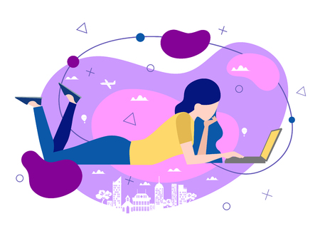 Casual young woman in jeans typing on a laptop computer as she lies on the floor above a stylised city skyline in a conceptual image.