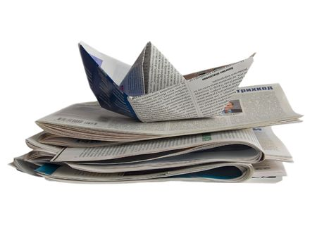 Newspaper origami boat isolated on white