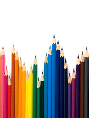 Assortment of colored pencils on white background
