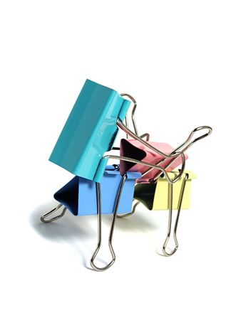 Colored paper clip isolated on white photo