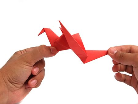 Origami crane in hand Stock Photo - 5938766
