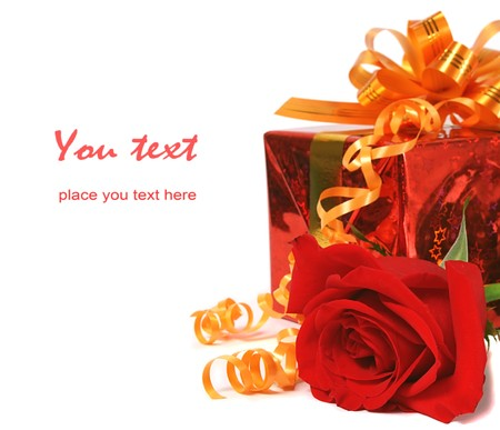 Red gift and red rose over white  photo