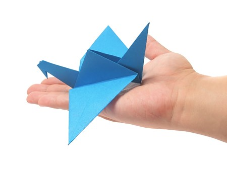 Origami crane in hand Stock Photo - 7575183