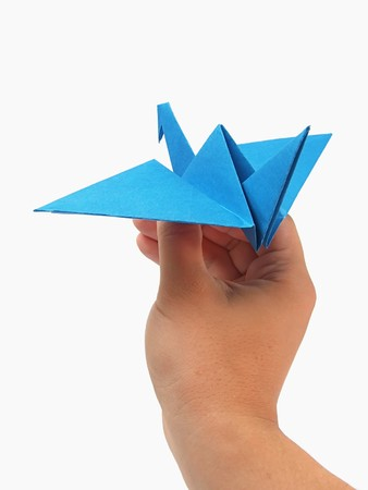 Origami crane in hand Stock Photo - 7575193