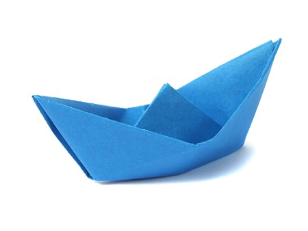 Close up origami ship isolated on white background