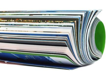 Curved magazine isolated on white background  photo