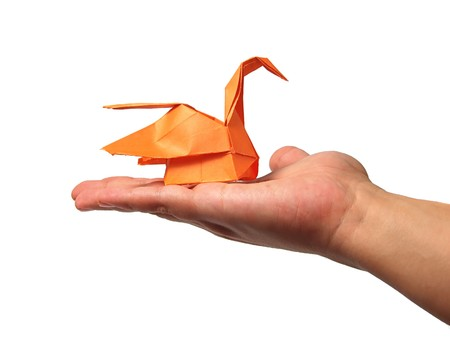 Origami swan in hand Stock Photo - 7575257