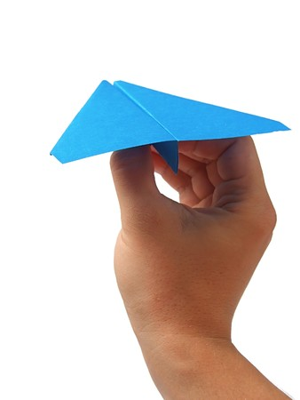 Origami airplane in hand