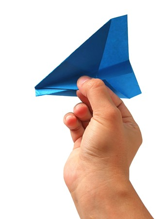 Origami airplane in hand photo