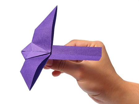 Origami bird in hand Stock Photo - 7602464