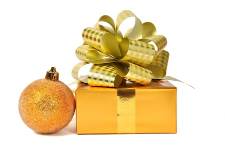 Golden gift with balls over white photo
