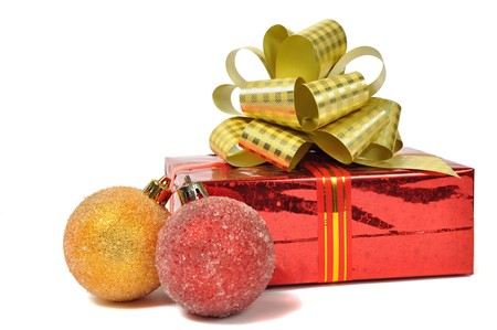 Red gift with balls over white photo
