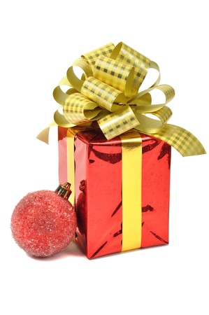 Red gift with ball over white photo