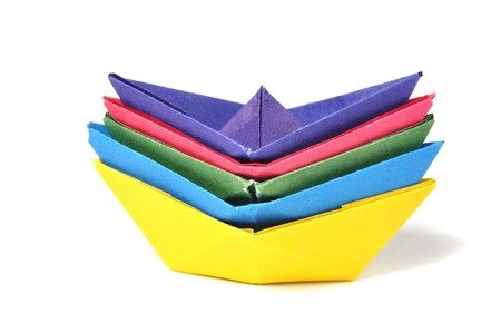 Close up origami ship over white