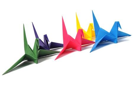 Origami cranes over white photo