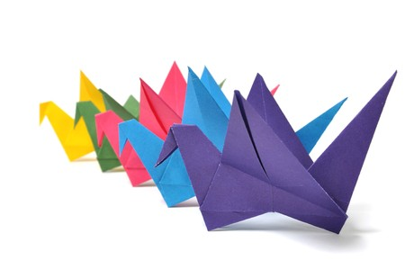 Origami cranes over white photo