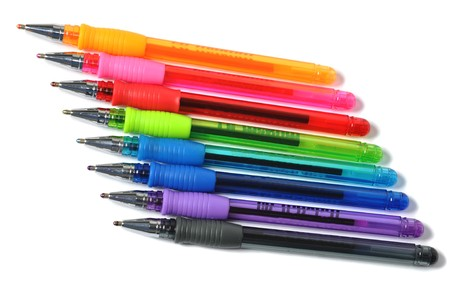 Assortment of colored ball-pen over white photo
