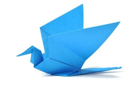 Origami bird over white photo