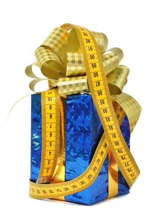Blue gift and measure tape over white photo