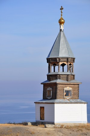 Russian wooden church on river coast photo