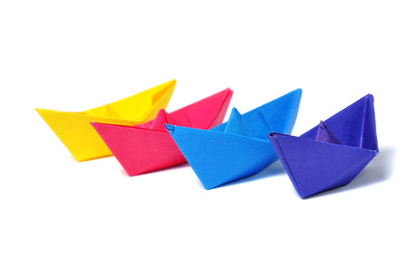 Close up origami ship over white photo