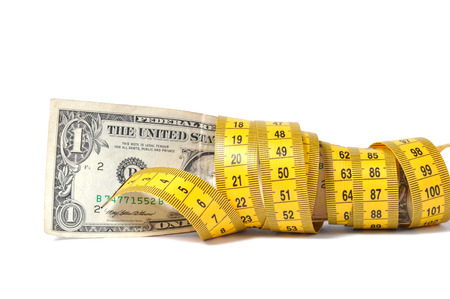 Dollar banknote and measure tape photo
