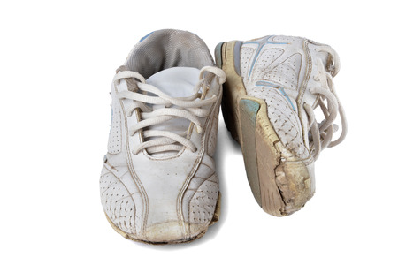 brand damage: Old sport shoes isolated over white background