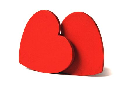 Two red hearts isolated on white