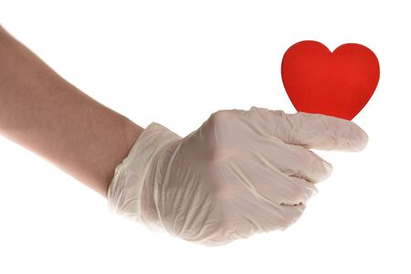 Hearts in hand with rubber gloves isolated on white Banco de Imagens