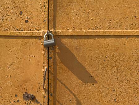 Iron access lock on brown antique door Stock Photo - 4680722