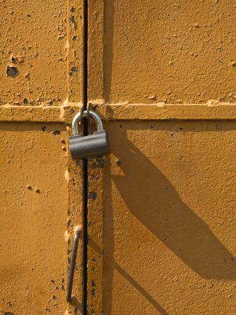 Iron access lock on brown antique door photo