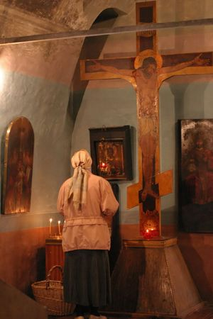 reclusion: Pray god at crucifix in church religion scene