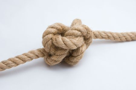 Tied up rope knot isolated on white background
