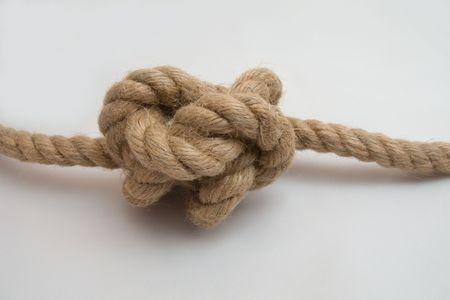 nudo: Atado la cuerda nudo aisladas sobre fondo blanco Foto de archivo