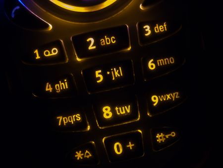 Mobile phone keypad back lit macro image on black photo