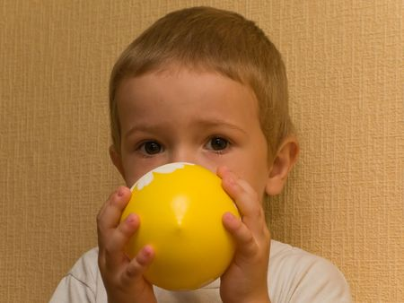 Little cheerful child inflating balloon for fun Stock Photo - 5089440