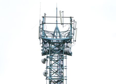Communications antenna tower with repeater equipment photo