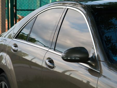 look through window: Car side view at driving door, window and mirror