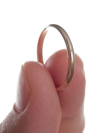 Gold wedding ring love engagement gift on white photo
