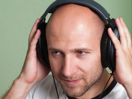 Adult men in sound headphones listening mp3 music Stock Photo - 5283245