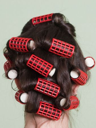 hair roller: Curlers hair roller on adult beauty women Stock Photo