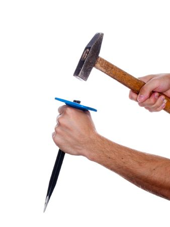 chisel: Human hand working with chisel tool and hammer Stock Photo